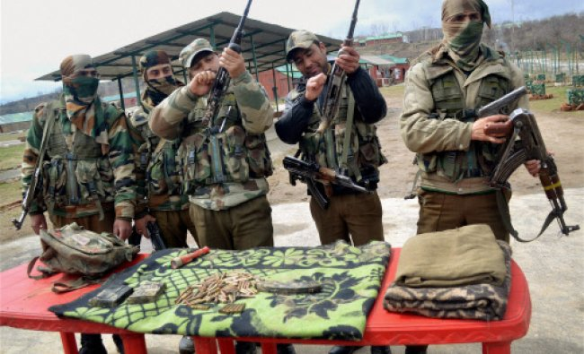Personnel from Special Operation Group of Jammu and Kashmir Police display the arms...