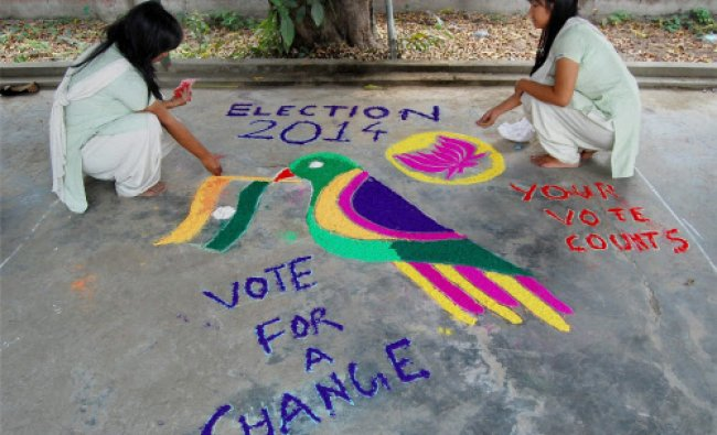 College students drawing a Rangoli in connection with forthcoming elections in Dibrugarh...