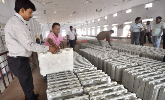 Polling officials check Electronic Voting Machines (EVM) for upcoming Lok Sabha elections...