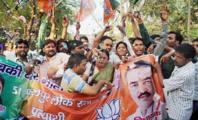 Supporters of BJP MLA Keshav Prasad Maurya jubilate after he was announced the party...