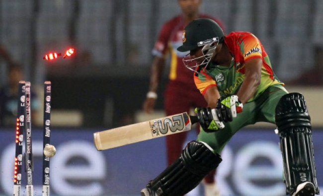 Bangladesh\'s Sohag Gazi is bowled out against West Indies\' during their ICC Twenty20 World Cup...