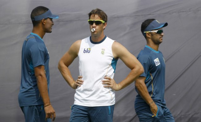 South Africa\'s Albie Morkel, center, Beuran Hendricks, and Jean-Paul Duminy...
