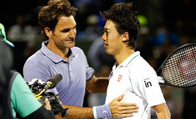 Mar 26, 2014; Miami, FL, USA; Kei Nishikori (R) shakes hands with Roger Federer ...