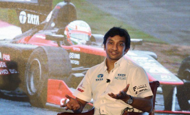 Formula One racer Narain Karthikeyan speaks duing a press conference ahead of his...