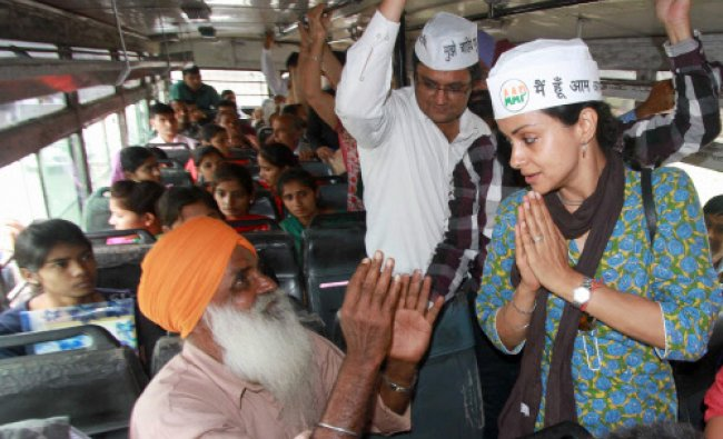 Aam Aadmi Party candidate Gul Panag with people in public transport bus during her...