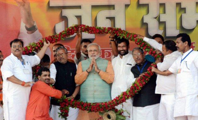 BJP PM candidate Narendra Modi, LJP chief Ram Vilas Paswan and other BJP-LJP leaders being...