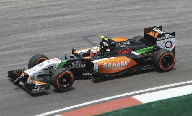 Force India driver Sergio Perez of Mexico steers his car during the second practice session...