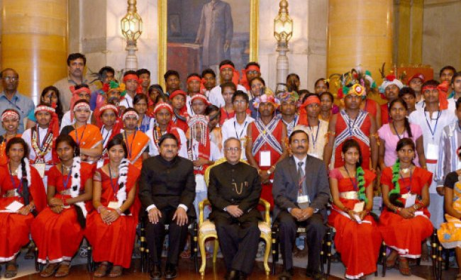 Pranab Mukherjee poses with the youths attending 6th Tribal Youth Exchange...