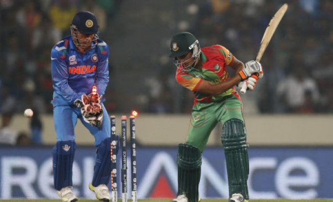 Bangladesh batsman Anamul Haque, right, is bowled out by India\'s Amit Mishra during their ICC...