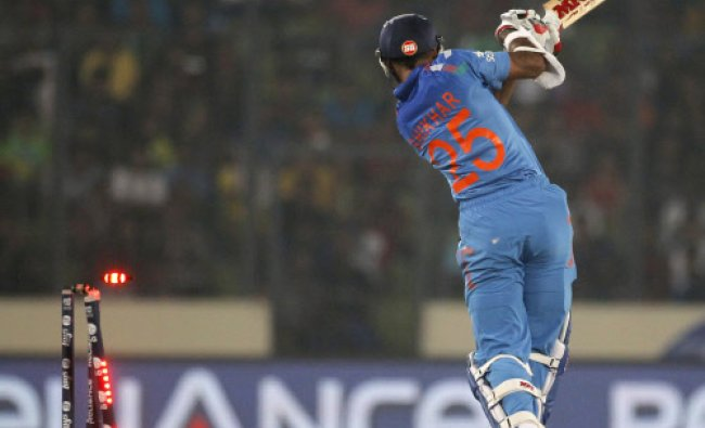 Shikhar Dhawan is bowled out against Bangladesh during their ICC Twenty20 World Cup match...
