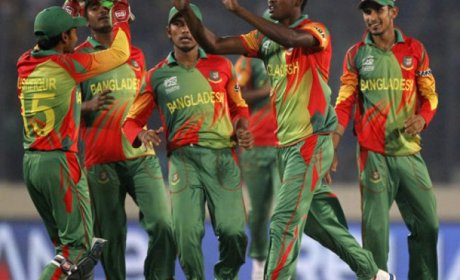 Bangladesh\'s fielders congratulate Al-Amin Hossain (2nd R) as he dismissed India\'s Shikhar Dhawan...