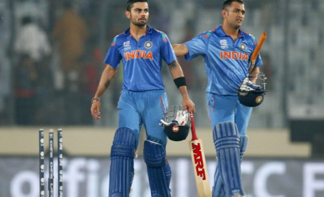 Mahendra Singh Dhoni, right, and teammate Virat Kohli celebrate their win over Bangladesh in the...