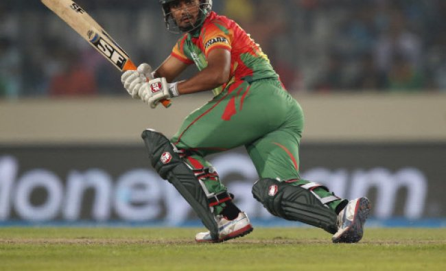 Bangladesh batsman Mahmudullah plays a shot during their ICC Twenty20 Cricket World Cup match...