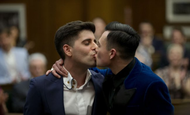 Sean Adl-Tabatabai, left, and Sinclair Treadway kiss each other after they were announced ...