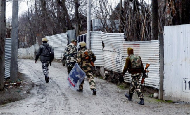 Army personnel at an anti-militant operation in Palhalen area of Baramulla district on Saturday...