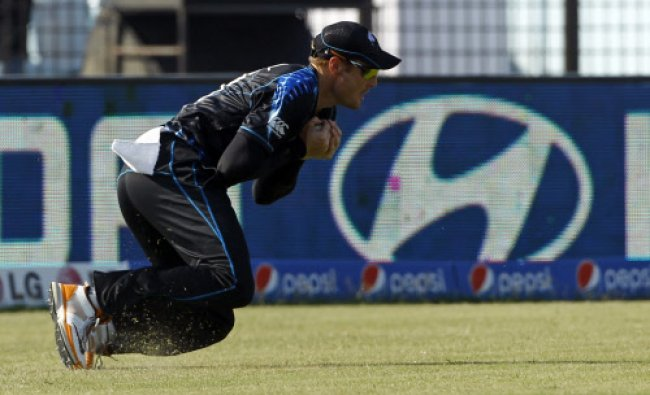 New Zealand\'s Martin Guptill takes a catch to dismiss Netherlands\' Stephan Myburgh during their...