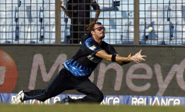 New Zealand\'s Kyle Mills stretches out in an unsuccessful attempt to catch the ball during...
