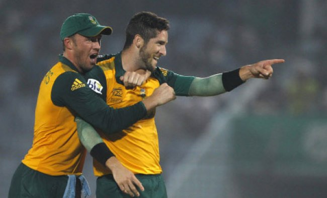 South Africa\'s Wayne Parnell, right, celebrates with his teammate AB de Villiers taking the...