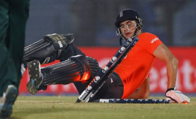 England\'s Alex Hales dislodges the wickets after taking a dive to complete a run during...