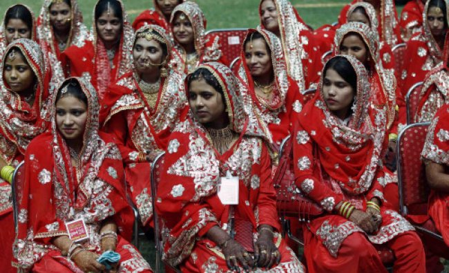 Muslim brides wait for the start of their mass marriage ceremony in the western Indian city...