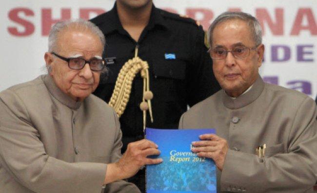 President Pranab Mukherjee receives a publications of IIPA from Chairman, IIPA, T N Chaturvedi...