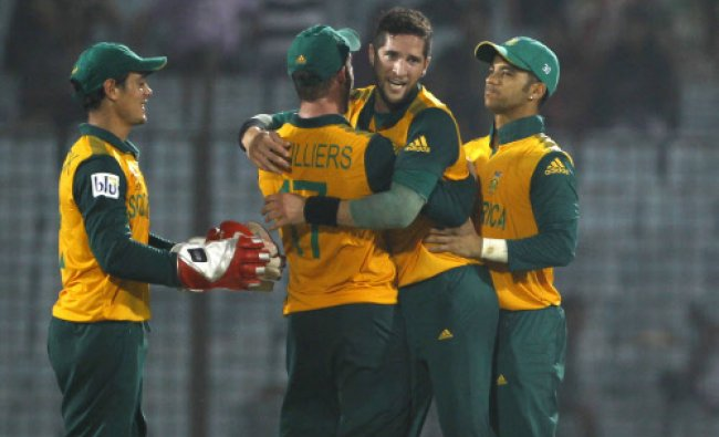 South Africa\'s Wayne Parnell, celebrate with his teammates taking the wicket of Alex Hales...