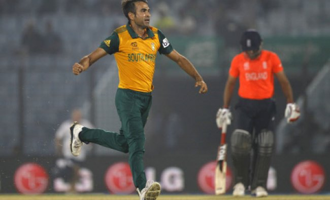South Africa\'s Imran Tahir, celebrates taking the wicket of England\'s Jos Buttler...