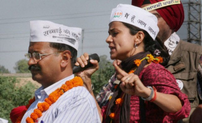 AAP convener Arvind Kejriwal with party candidate Gul Panag during an election campaign in ...