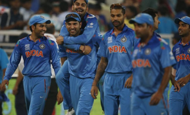 India\'s Yuvraj Singh, second left, carries teammate Virat Kohli on his back as they celebrate ...