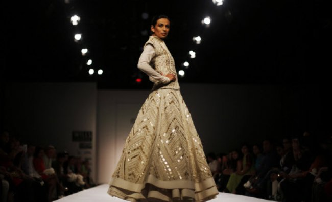 A model displays a creation by Sahil Kochhar, during the Wills Lifestyle India Fashion Week ...