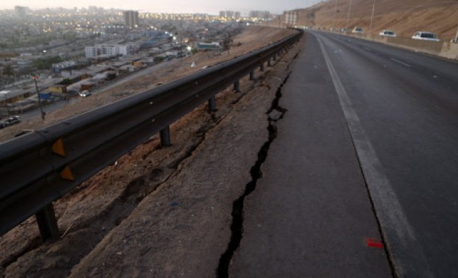 A view of a damaged road to Alto Hospicio commune after an earthquake and tsunami hit ...