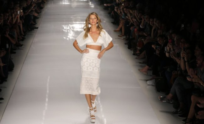 Brazilian model Gisele Bundchen presents a creation from Colcci\'s Summer 2015 collection ...