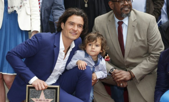 Actor Orlando Bloom of Britain (L) poses with his son Flynn and actor Forest Whitaker ...