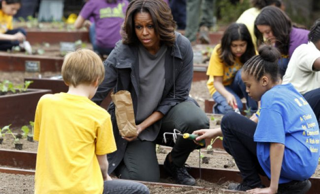 U.S. first lady Michelle Obama and local schoolchildren plant the sixth annual White House ...