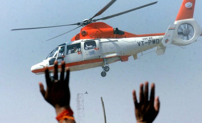 Sonia Gandhi waves to supporters from a chopper after an election rally in Sasaram ...