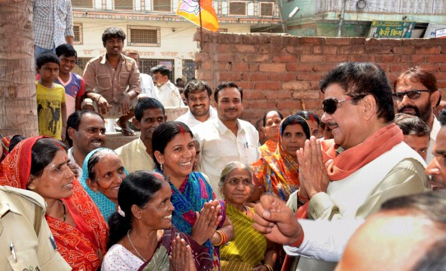 BJP candidate Shatrughan Sinha meeting women voters during his election campaign in Patna ...