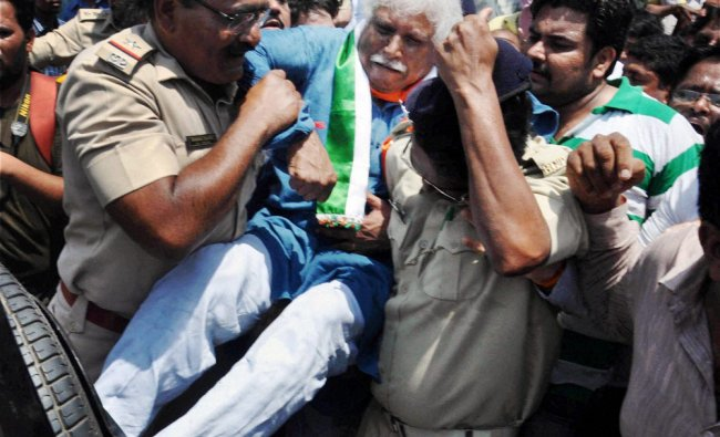 Police detain Congress candidate Madhunsudan Mistry for tearing off posters of Modi ...