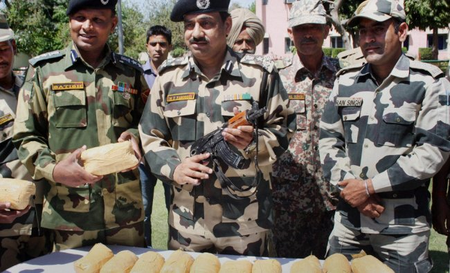BSF officers and jawans display 13 kgs of heroin recovered from Mullakot Outpost in Amritsar ...