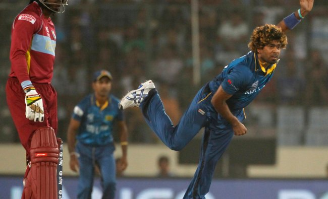 Sri Lanka\'s Malinga bowls as West Indies\' Gayle watches during their semi-final match ...