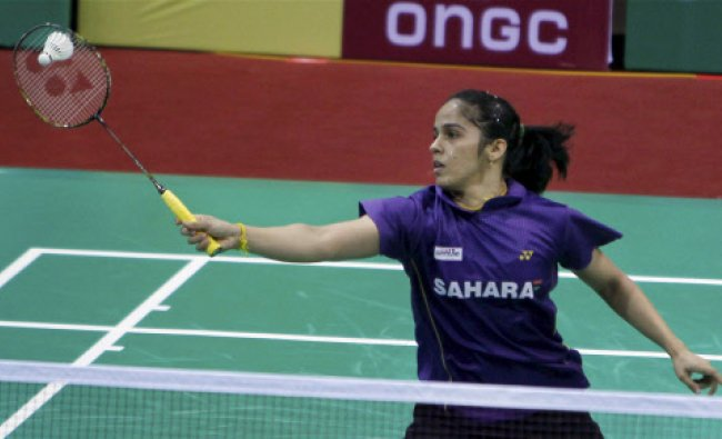 India\'s Saina Nehwal plays a shot during Women\'s singles match against Natcha Saengchote of ...