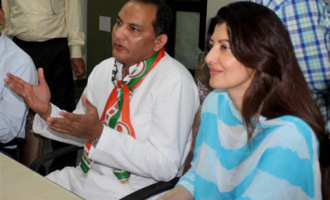 Congress candidate Mohammad Azharuddin, with Sangeeta Bijlani, filing his nomination papers in...