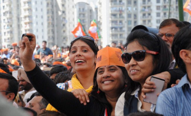 Supporters during BJP Prime Ministerial candidate Narendra Modi\'s election campaign rally in...