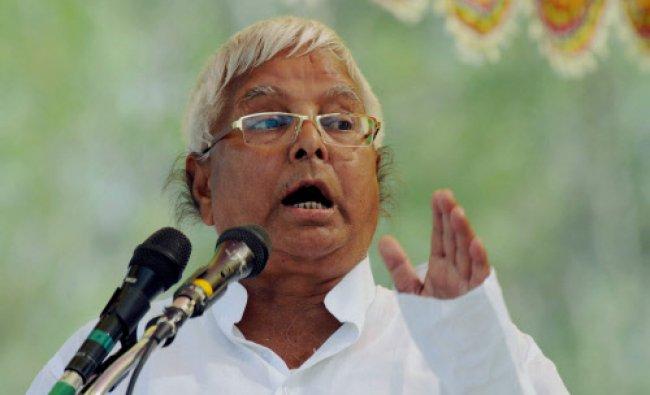 Rashtriya Janata Dal chief Lalu Prasad Yadav addresses an election rally at Chhatarpur near...