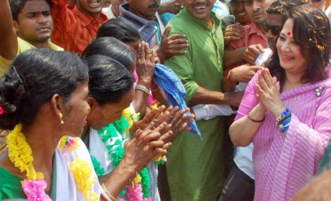 Actress and TMC candidate Moonmoon Sen greets tribal women at the party workers\' convention in...