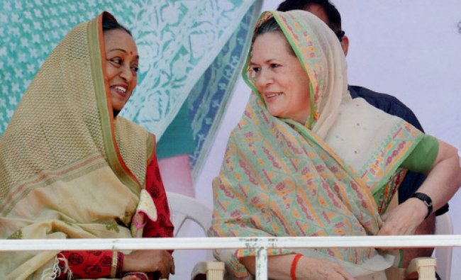 Congress President Sonia Gandhi with party Lok Sabha candidate Meira Kumar during an election...
