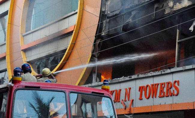 Fire personnel dousing a major fire that broke out at Rukmani towers in Secundrabad ...