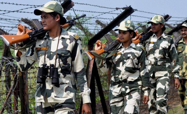 Women Border Security Force personnel patrol the border with Bangladesh near Agartala ...