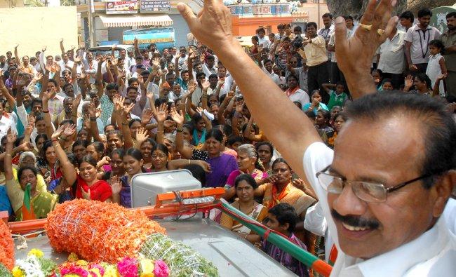 BJP North Bangalore Lok Sabha candidate D V Sadananda Gowda leads a campaign rally at Bagalagunte ..