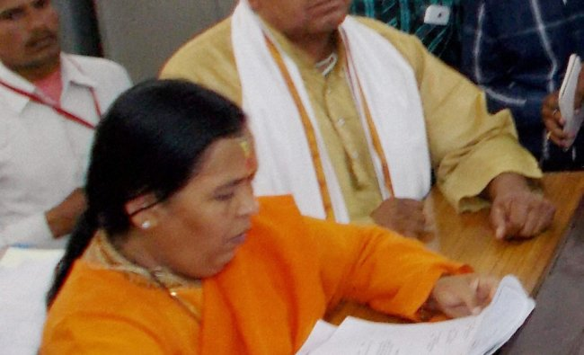 BJP leader Uma Bharti filing her nomination papers in Jhansi on Friday...