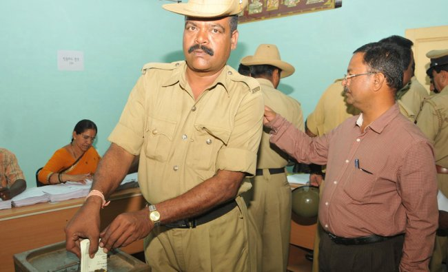 Karnataka State Reserve Police cast their vote during Postal Voting at KSRP in Mysore ...